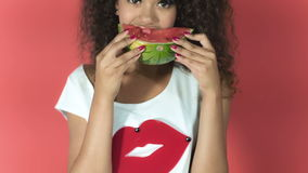 Portrait Of Fashion African Model Eating A Watermelon In Studio stock footage