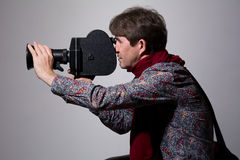 Portrait of a fashion cameraman with old movie camera Stock Photography