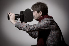Portrait of a fashion cameraman with old movie camera Stock Images