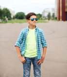 Portrait fashion child boy wearing a sunglasses and shirt Royalty Free Stock Photos