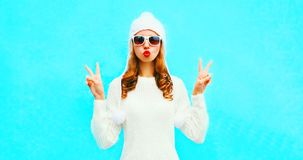 Portrait fashion cool girl blowing red lips sends an air kiss royalty free stock photography