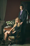 Portrait of a fashion couple in elegant house Royalty Free Stock Image