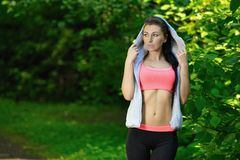 Portrait of fashion fitness model posing in park Royalty Free Stock Photo
