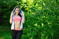 Portrait of fashion fitness model posing in park Royalty Free Stock Images