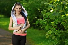 Portrait of fashion fitness model posing in park Stock Image