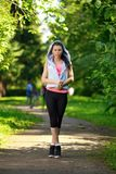 Portrait of fashion fitness model posing in park Royalty Free Stock Photos