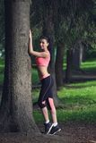 Portrait of fashion fitness model posing in park Stock Photo