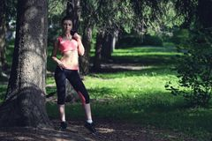 Portrait of fashion fitness model posing in park Royalty Free Stock Image