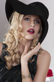 Portrait of a fashion girl with black hat Royalty Free Stock Images