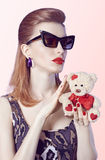 Portrait Fashion  girl in glasses, Loving teddy Royalty Free Stock Photos