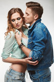 Portrait of fashion glamor stylish swag young couple. Wearing jeans in studio Stock Images