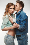 Portrait of fashion glamor stylish swag young couple. Wearing jeans in studio Stock Photo