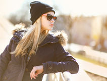 Portrait fashion hipster girl in the city in sunny day Stock Images