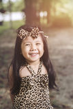 Portrait fashion a Little Girl Asian  in Tiger Pattern Dress. Portrait fashion a Little Girl Asian  in Tiger Pattern Dress Smile happily at the dress she put on Stock Image