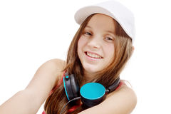 Portrait of fashion little girl with blue headphone, on white Stock Photo