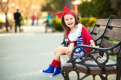 Portrait of fashion little girl in a park Royalty Free Stock Photography