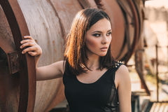 Portrait Of Fashion Model Girl On The Industrial Background Stock Photography