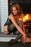 Portrait Fashion model posing in front fireplace Royalty Free Stock Images