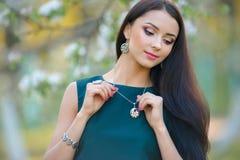 Portrait fashion model wear stylish designer jewelry and accesso. The portrait fashion model wear stylish designer jewelry and accessory at the spring garden Stock Images
