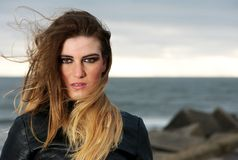 Portrait of a fashion model with wind blowing long hair Royalty Free Stock Images