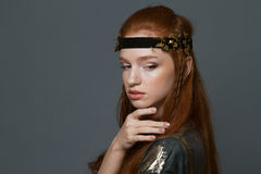Portrait of a fashion redhead woman. Posing over gray background royalty free stock photo