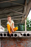 Portrait of Fashion smiling Model Girl on the Industrial Background Royalty Free Stock Images