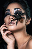 Portrait of fashion woman model. Portrait of beautiful asian girl with spider Stock Photos