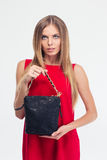Portrait of a fashion woman in red dress holding bag Royalty Free Stock Photos