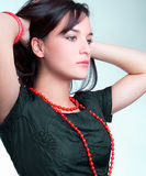 Portrait of fashion woman with red necklace Stock Photography