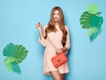 Blonde young woman in floral spring summer dress royalty free stock photos