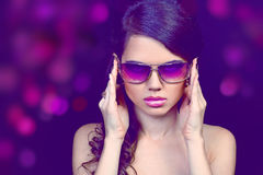 Portrait of fashion young woman in sunglasses Stock Photos