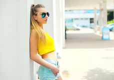 Portrait fashion young woman wearing a sunglasses and t-shirt Stock Image