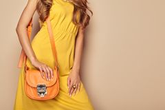 Blonde young woman in yellow spring summer dress royalty free stock photography
