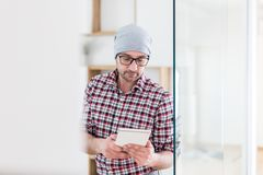 Portrait of fashionable architect or designer with tablet device standing at the office royalty free stock image