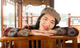 Portrait of fashionable asian girl in a wooden tourist boat. Portrait of fashionable pretty asian girl in a wooden tourist boat Royalty Free Stock Images
