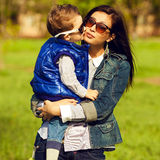 Portrait of fashionable baby boy and his gorgeous mother Stock Images
