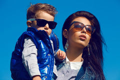 Portrait of fashionable baby boy and his gorgeous mother Royalty Free Stock Images