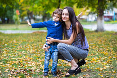 Portrait of fashionable baby boy and his mother Royalty Free Stock Photo