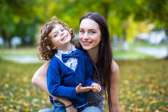 Portrait of fashionable baby boy and his mother Stock Images