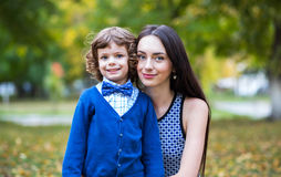 Portrait of fashionable baby boy and his mother Royalty Free Stock Photography