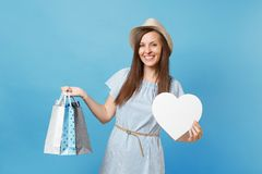 Portrait fashionable beautiful woman in summer dress, straw hat holding packages bags with purchases after shopping royalty free stock photography