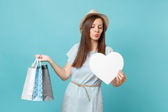 Portrait fashionable beautiful woman in summer dress, straw hat holding packages bags with purchases after shopping stock image