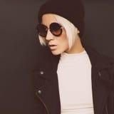Portrait fashionable blonde on a black background. Autumn style Stock Photos