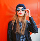Portrait of fashionable blonde girl with red lipstick Royalty Free Stock Images
