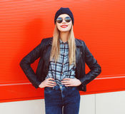 Portrait of fashionable blonde wearing a rock black style Stock Photo