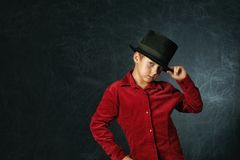 Portrait of a fashionable boy close-up on a dark background royalty free stock photography