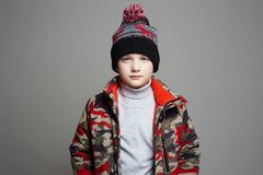 Portrait of Fashionable Boy in winter outerwear royalty free stock images