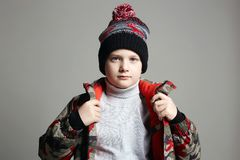 Portrait of Fashionable Boy in winter outerwear royalty free stock photo