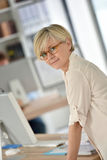 Portrait of fashionable businesswoman at office Stock Photo