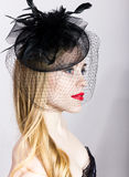 Portrait of a fashionable Elegant beautiful girl with red lips and a veil Royalty Free Stock Photos